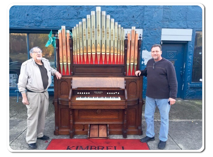Stan and Coleman Kimball with large organ they restored